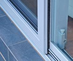 Weatherproof sliding screen door