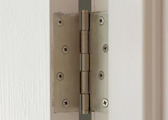 Wooden door with squeeky hinge