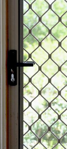 Repaired fly screen door