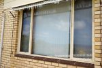 Replace large wooden windows with aluminium windows before
