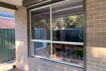 replace wood in aluminium window outside after