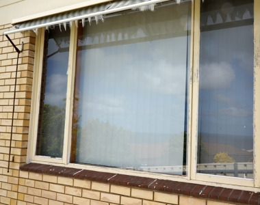 Replace large wooden windows with aluminium windows